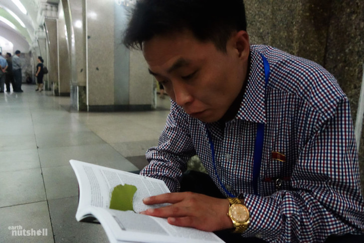 a-north-korean-tour-guide-reads-a-guidebook-brought-in-the-country-by-a-tourist-he-was-fascinated-as-to-what-people-from-the-outside-world-say-about-his-beloved-country