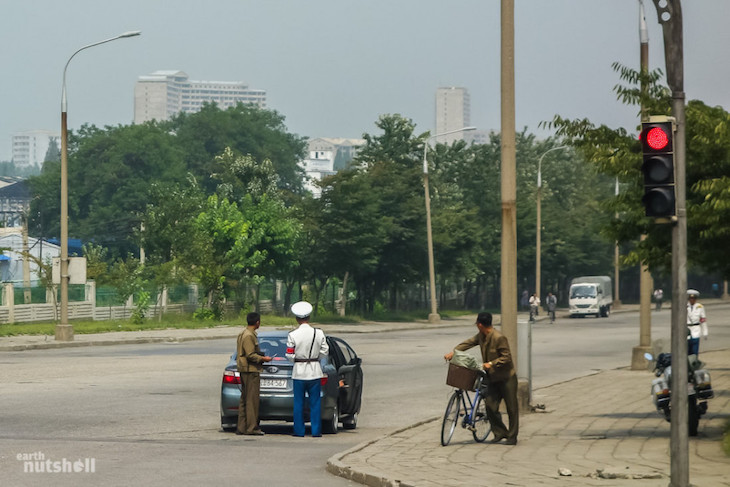 a-pyongyang-local-chatting-to-a-city-police-officer-after-being-pulled-over