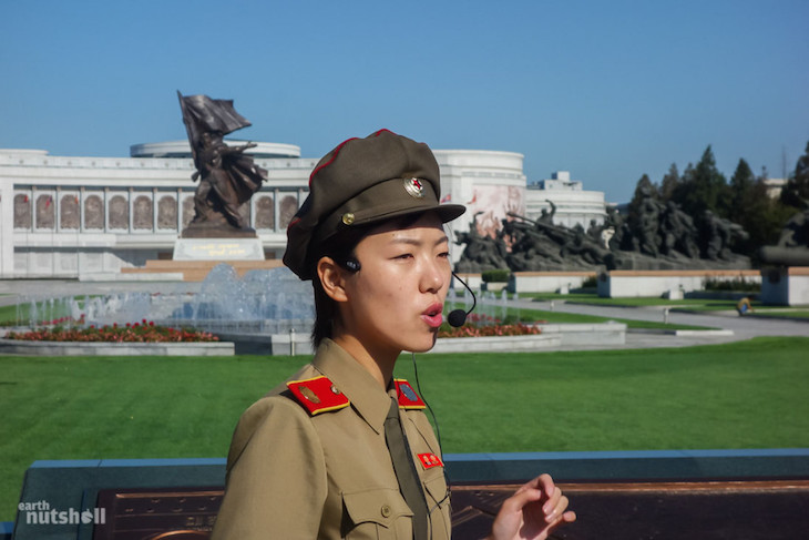 a-local-guide-giving-a-recap-on-the-korean-war-in-the-beautiful-preceding-gardens-to-the-victorious-fatherland-liberation-war-museum