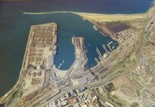 Aerial view of harbour showing the sand accumulated against the breakwater over the years