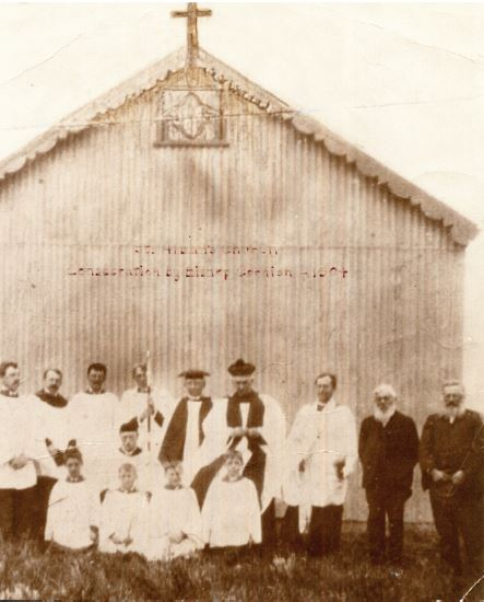 Consecration of the church by Bishop Cornish pictured in the centre with members of the clergy and choir