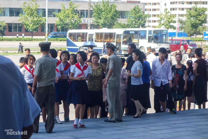locals-being-given-instructions-outside-the-pyongyang-circus-theatre