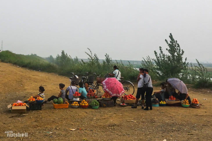locals-selling-local-produce-in-the-middle-of-a-dirt-road-between-haeju-and-sariwon