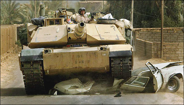 M1A1 Abrams in Baghdad riding over a car