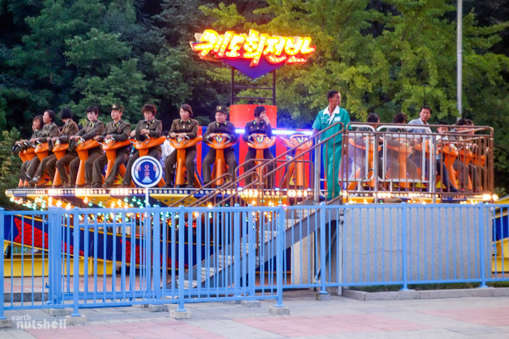 soldiers-from-the-korean-peoples-army-enjoying-some-rides-in-the-pyongyang-funfair-in-uniform