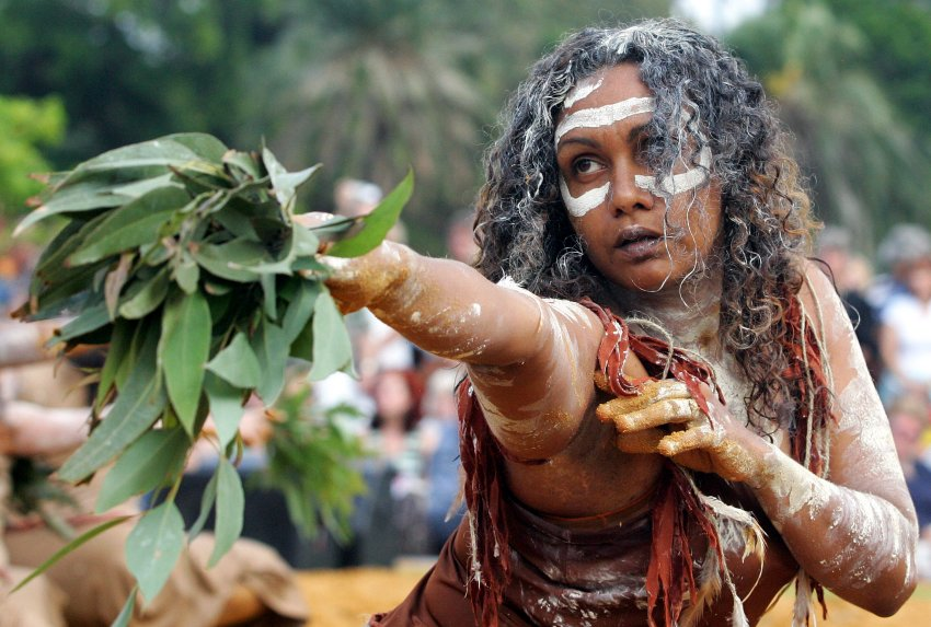 An aboriginal woman perform the Woggan-ma-gule morning ceremony on Australia Day in Sydney, Friday, Jan. 26, 2007. Australia Day marks the arrival of the first European settlers in 1788. (AP Photo/Paul Miller)