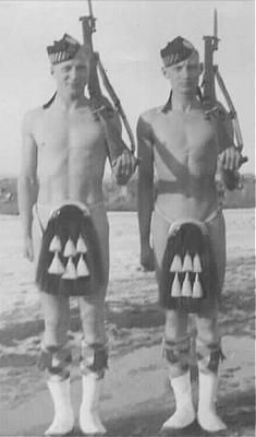 two-calgary-highlanders-stand-by-the-baks-of-the-bow-river-calgary-before-departing-for-the-war-they-are-humourously-depicting-canadas-equipment-shortages