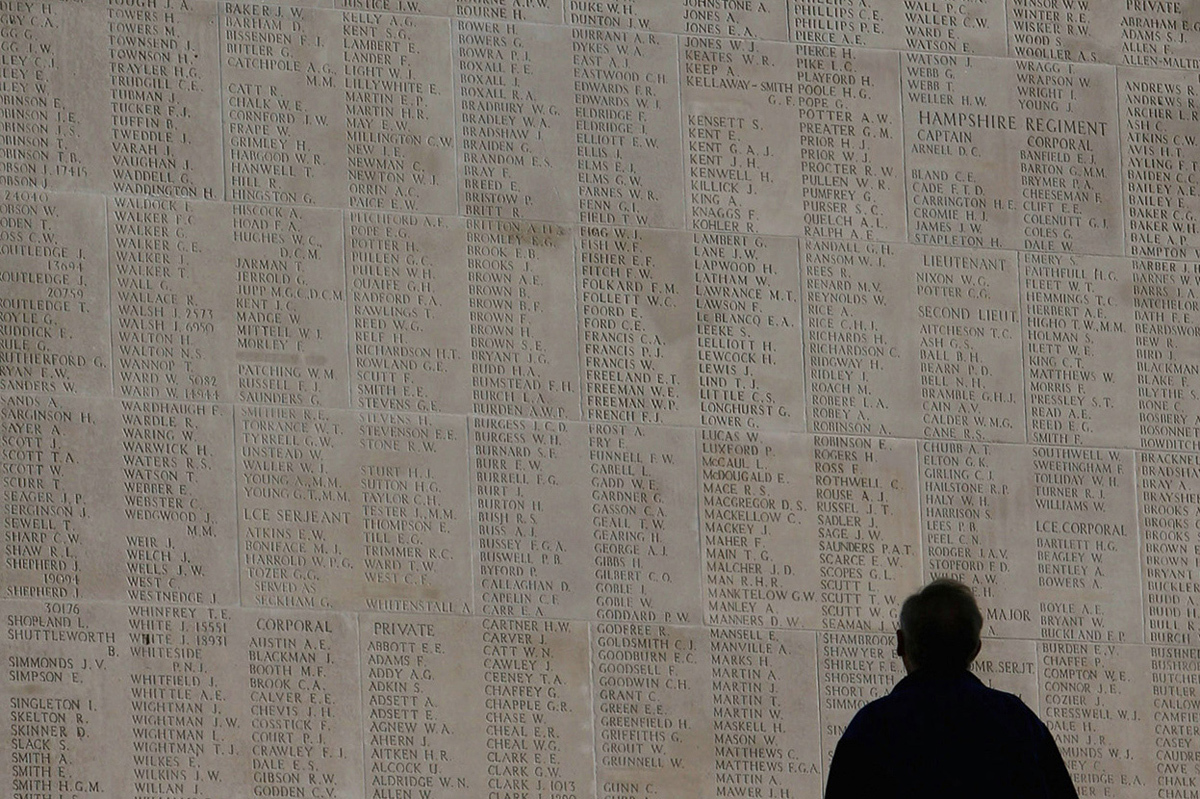 A man looks at the names of the missing on the Thiepval Memorial in Arras, France