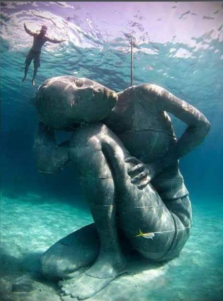 Eighteen foot underwater statue in the Bahamas