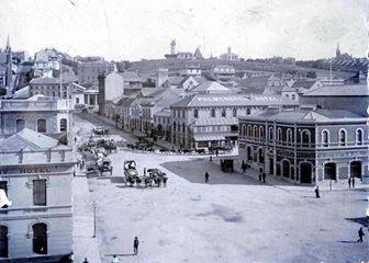 The first building on the right, is the railway station & the next building is the Palmerston Hotel