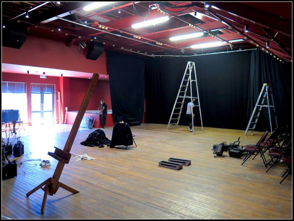 The Barn Theatre with staff busy preparing the space for the next production