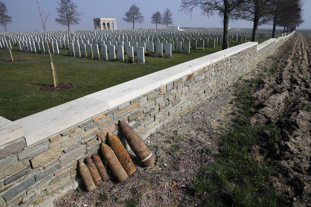 Unexploded shells are lined up along a wall awaiting removal by bomb-disposal experts after a French farmer found them while plowing his fields