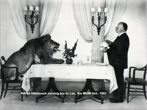 Alfred Hitchcock serving tea to Leo the Lion
