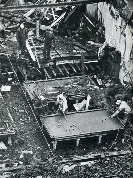 Demolition workers play a game after a fire in a billiard parlor, 1969
