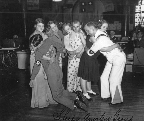 Last four couples standing at a Chicago dance marathon, c. 1930