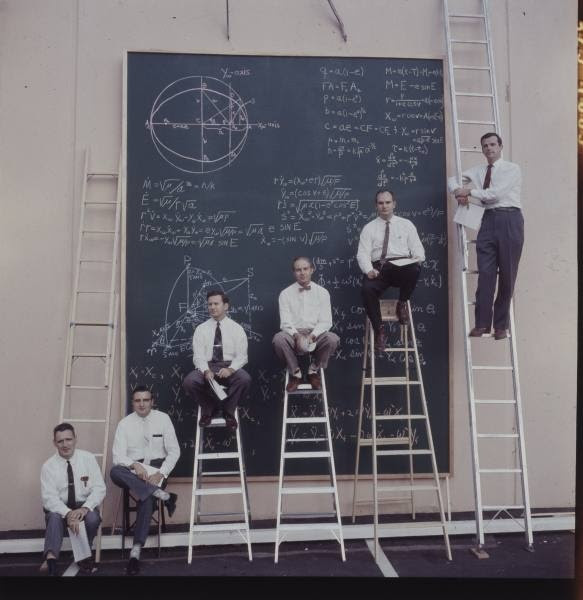NASA scientists with their board of calculations, 1960s