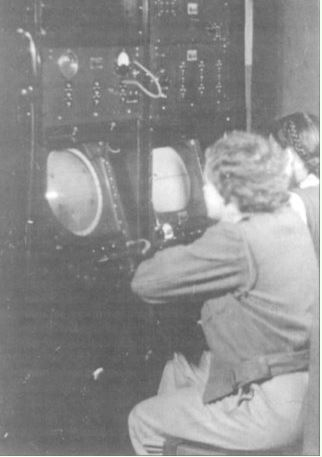 Operators read the screens of a COL radar