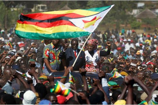 "Zimbabwe's President Robert Mugabe and his wife Grace greet supporters of his ZANU (PF) party during the ""One Million Man March"", a show of support of Mugabe's rule in Harare, Zimbabwe, May 25, 2016"