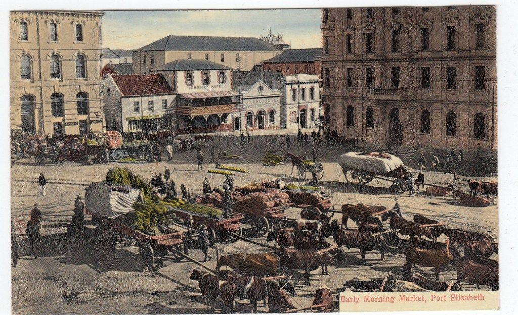 Morning market with ox wagons & Terminus Hotel in background