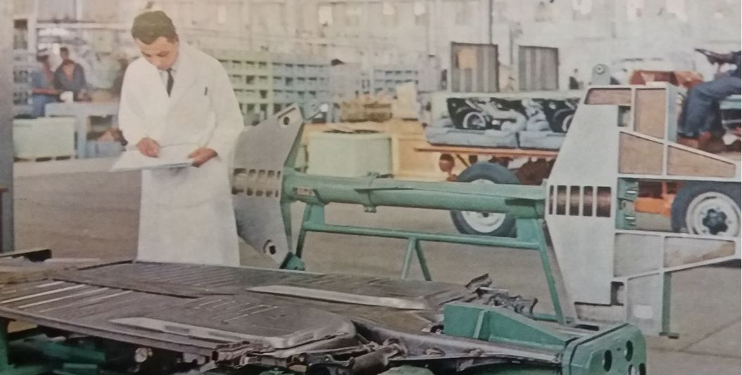 A SAMAD inspector checks the functional dimenions of a VW locally manufactured 1300 floor frame on a final acceptance gauge