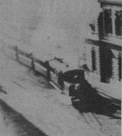 The train travelling through town